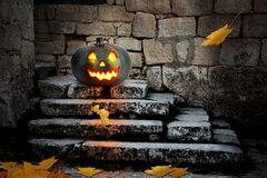 Halloween pumpkins in the yard of an old house Royalty Free Stock Images