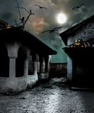 Halloween pumpkins in the yard of an old house stock illustration