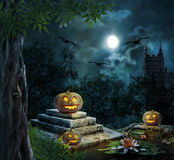 Halloween pumpkins in yard of old house night Stock Images
