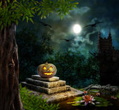 Halloween pumpkins in yard of old house night Royalty Free Stock Images