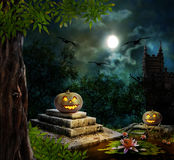 Halloween pumpkins in yard of old house night in moonlight Royalty Free Stock Images