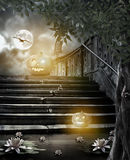 Halloween pumpkins in yard of of old stone staircase night in br Royalty Free Stock Photo