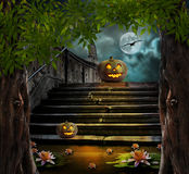Halloween pumpkins in yard of of old stone staircase night Royalty Free Stock Photography