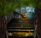 Halloween pumpkins in yard of of old stone staircase night Stock Images