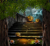 Halloween pumpkins in yard of of old stone staircase night Stock Image