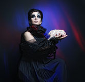 Halloween queen with chicken carcass Royalty Free Stock Images