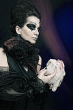 Halloween queen with chicken carcass Stock Images