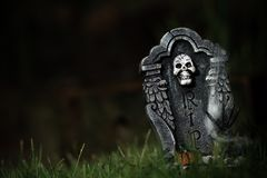 Halloween RIP tombstone. With spider on grass with dark background Stock Photo