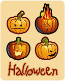 Halloween's drawing - four pumpkin heads of Jack. O-Lantern ; one is on fire Royalty Free Stock Photography