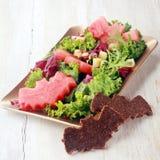 Halloween-Salat mit dem geformten Schläger schmückt Stockbild