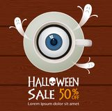 Halloween sale background. Halloween coffee,eye  and sale text on wood background Stock Image