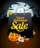 Halloween sale design with festive attributes. Halloween sale design with paper bag and festive attributes in a nightscape Stock Photo