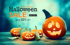 Halloween sale with pumpkins at night Stock Illustration