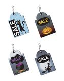 Halloween Sale Tags. With a witch,potion,pumpkin and cat Royalty Free Stock Image