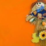 Halloween Scarecrow. Halloween Scarecrow on orange background Stock Images