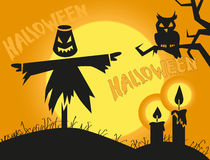 Halloween scarecrow and candles Royalty Free Stock Image