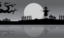 Halloween scarecrow silhouette in the riverbank Stock Photo
