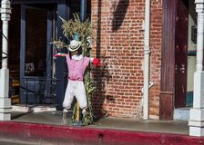 Halloween Scarecrow Outside Retail Stores. Halloween Scarecrow On Street Outside Retail Stores Royalty Free Stock Photography