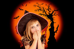 Halloween scared blond kid girl Stock Photos