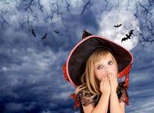 Halloween scared kid girl on dark moon sky. Halloween scared kid girl on dark sky and moon with bat royalty free stock photo