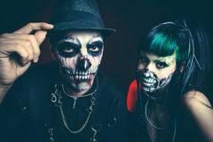 Halloween scary cyber skeleton woman and man with hat studio. Halloween scary cyber skeleton women and men with hat studio shot royalty free stock photo