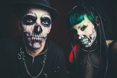 Halloween scary cyber skeleton woman and man with hat studio Royalty Free Stock Photos