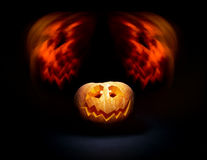 Halloween scary face pumpkin on the black backdrop Stock Photos