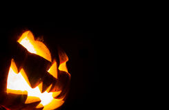 Halloween scary face pumpkin. On black background royalty free stock photography