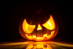 Halloween scary face pumpkin. On black background stock images