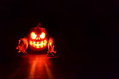 Halloween scary face pumpkin. On black background Royalty Free Stock Images