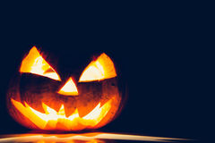 Halloween scary face pumpkin ( Filtered image processed vintage Royalty Free Stock Images
