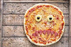 Halloween scary food funny monster face pizza horror snack with mozzarella Royalty Free Stock Photography