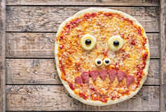 Halloween scary food funny monster zombie face pizza horror snack Stock Photo
