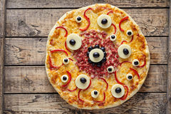Halloween Scary Food Monster Pizza With Eyes On Vintage Wooden Table Royalty Free Stock Images