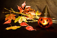 Halloween scary pumpkin. Celebrating Halloween night with scary pumpkin candle and dead leaves royalty free stock photos