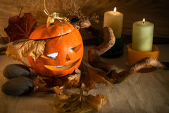 Halloween: Scary Pumpkin and candles Royalty Free Stock Photos