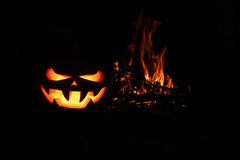Halloween Scary Pumpkin fireplace with fire, isolated in the dar. K royalty free stock photo