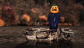Halloween scary pumpkin ghost face with blood. Halloween a scary pumpkin ghost face with blood on a boat stock photos