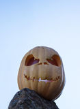 Halloween scary pumpkins on the rock and sky background Royalty Free Stock Photo