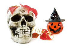 Halloween scary skull and pumpkin. Celebrating autumn and Halloween with scary skull, smiling pumpkin and red leaves. Isolated on white background royalty free stock images