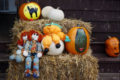 Halloween scene. Halloween pumpkins and dolls decorate a doorstep Royalty Free Stock Image