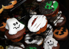 Halloween Scene. Abstract Homemade Halloween Cakes Scene Stock Images
