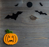 Halloween scene with bat and moon against Stock Photo
