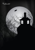 Halloween scene with haunted house, trees and bat Royalty Free Stock Image