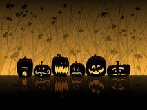 Halloween scene with jack-o-lanterns. Six jack-o-lanterns sit in the woods on Halloween Stock Images