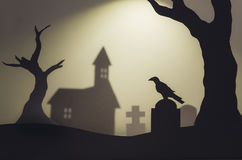 Halloween scene with silhouettes of crow in church graveyard Stock Photo
