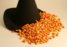 Halloween Scene with Witch's Hat, Candy Corn. Halloween scene of a witch's hat with candy corn royalty free stock photography