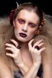 Halloween-Schönheitsfrauenmake-up Stockfoto
