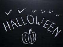 Halloween-schets op bord wordt getrokken dat stock afbeelding
