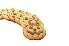 Halloween-Schokoladenplätzchen in der Form des Kürbises Lizenzfreie Stockfotografie